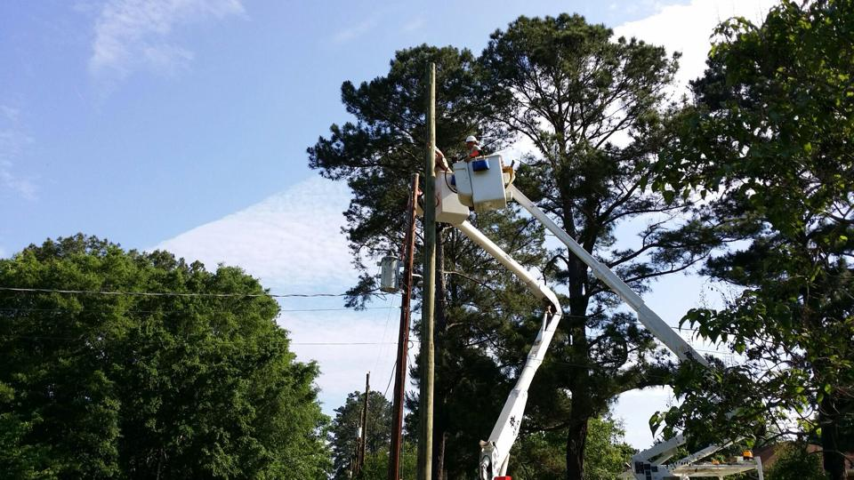 A bucket truck working on power lines